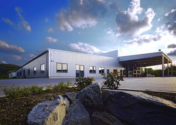 Erweiterung Betriebsgebäude um eine Lagerhalle mit Vordach